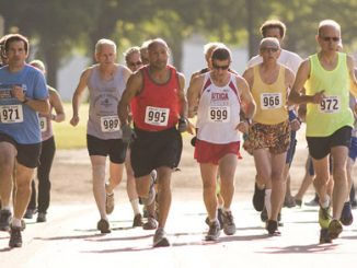 Runners leave the starting line in last year's 5K run at the Empire State Senior Games. Keith Eggleston, of Groton, number 972, won the race with a time of 18:23.