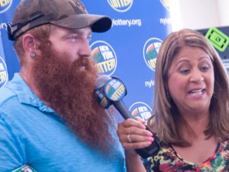 New York Lottery representative Yolanda Vega interviews lottery winner Lee Houghtling, 26, of Groton, Wednesday at the Dryden Xtra Mart after he won $1 million on a New York Poker scratch-off ticket. Houghtling, who received a total payment of $536,058 after taxes, said he plans to pay off debt and buy his mother a new car.