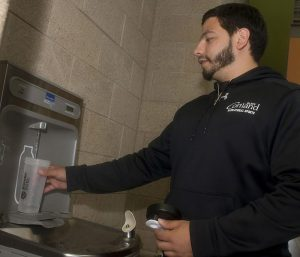 SUNY Cortland senior Christian Berenguer fills his water bottle Tuesday at a filling station in the Student Life Center. In an effort to eliminate mountains of plastic bottles going into landfills, the college has joined with Auxiliary Service Corp., which provides food and utility services for the school, to install water refill stations and sell reusable water bottles.