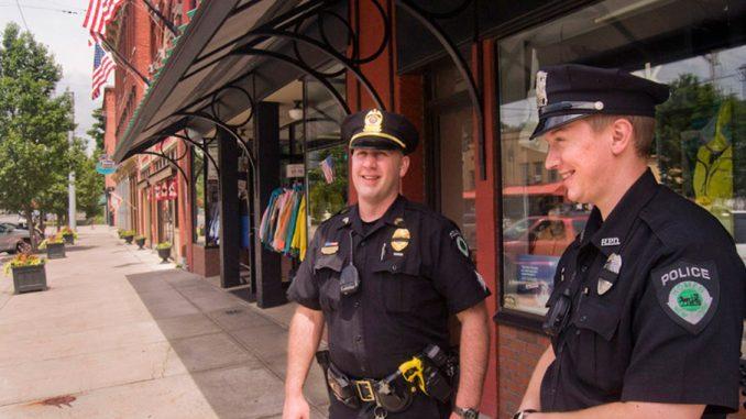 Homer Village Police Department Sgt. R.J. Eckard, left, and Polic Officer Matt Compton patrol historic Main Street on Monday afternoon.