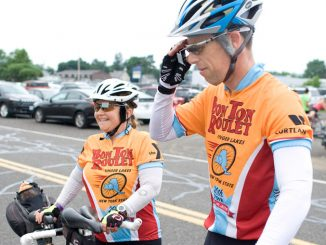 Dawn Felsen, left, and her husband, Alan, of Washington, D.C., finish the Bon Ton Roulet on a tandem bicycle Saturday at the Cortland County Fairgrounds in Cortlandville.
