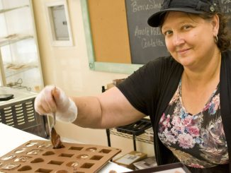 Stacey Pryor, owner of Sinfully Sweet Cafe, 17 S. Main St., Homer, makes custom chocolates Wednesday.