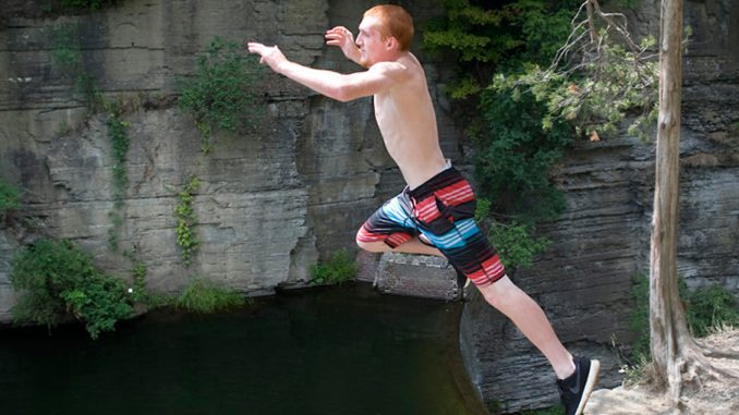 Troy Ludolph, 17, of Newark, leaps from a high ledge above Second Dam on Thursday.