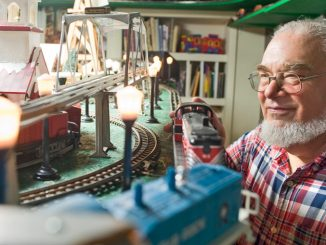 Model train collector Doug Deer of Cortland has an extensive model train collection in his basement. He is seen here Thursday.