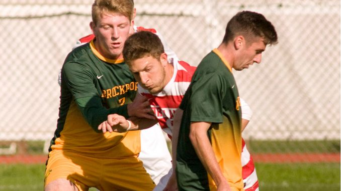 SUNY Cortland captain Nick Tata, center, shown splitting between two Brockport defenders last season, returns after topping the team with 10 goals in 2015.