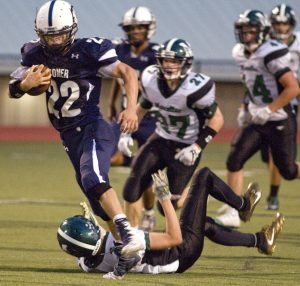 John Horner of Homer runs over a Marcellus player on his way to a 70-yard run from scrimmage Friday night at Butts Field.