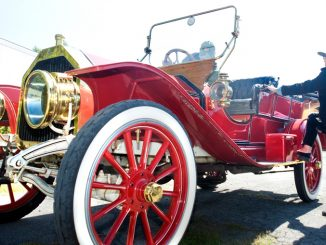Rene Green, of Lancaster County in Pennsylvania, steps down from her 1910 Buick on Friday after arriving at the CNY Living History Center in Cortlandville while on a tour of New York state.