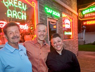 Former Green Arch Restaurant owner John Michael Discenza, left, stands with new owners Matt Petrella and his sister Shannon Petrella on Friday outside their Italian restaurant on Elm Street in Cortland.
