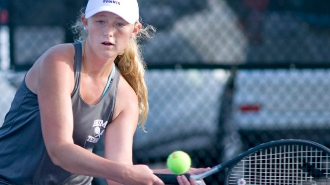 Homer Central's Molly Burhans belts a backhand during her first singles victory over Cortland's Allison Holl Wednesday at SUNY Cortland.