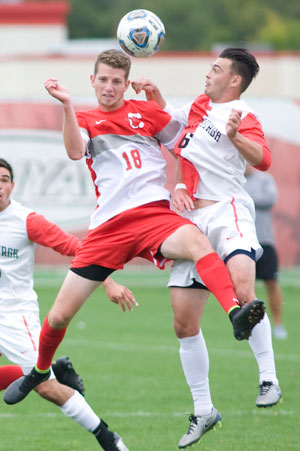 SUNY Cortland's Daniel Friend (18) heads the ball away from Plattsburgh's Ryan Miller (6) in the second half Saturday at Jets Field.