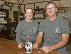 Bob Ellis/staff photographer Vince and Donna Pedini, proprietors of Dragonfyre Distillery, sit at the bar of the business at 1062 Leonard Road in Marathon.